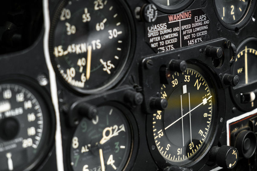 instruments Accuracy Air Vehicle Airplane Close-up Cockpit Communication Control Control Panel Full Frame Gauge Indoors  Metal Mode Of Transportation No People Number Speedometer Technology Text Transportation Vehicle Interior