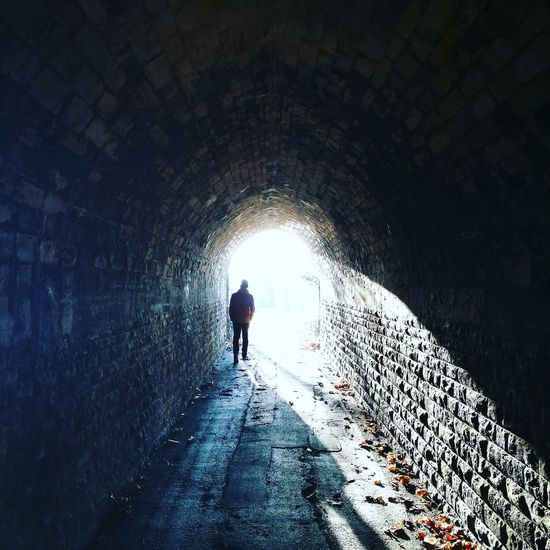 Tunnel Walking Light At The End Of The Tunnel Adventure Silhouette The Way Forward Leisure Activity Real People Vacations Cold Temperature Nature Indoors  One Person People Adult One Man Only Adults Only Day