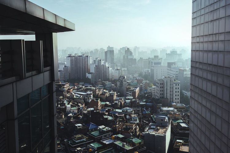 View to the east City Building Exterior Architecture Cityscape Built Structure Skyscraper No People Modern Urban Skyline Outdoors Air Quality Seoul Korea Cityscapes Skyline Skyscrapers ASIA Asian Cities Bad Air Smog Fog Foggy Smoggy Urban Landscape View From Above
