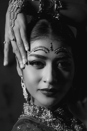 Portrait of beautiful young woman in traditional clothing