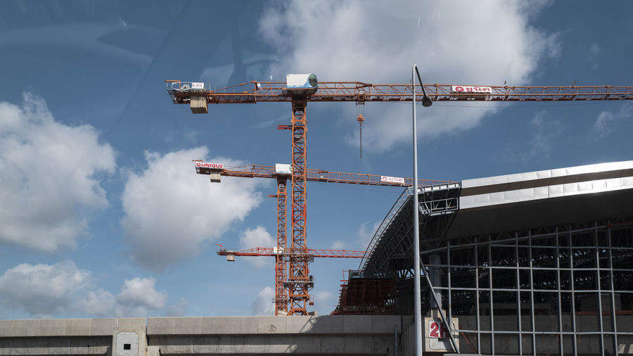 Cloud - Sky Built Structure Architecture Sky Low Angle View Construction Industry Machinery Crane - Construction Machinery Industry Nature Construction Site Development Building Exterior Day No People Incomplete Outdoors Connection Building Transportation Construction Equipment