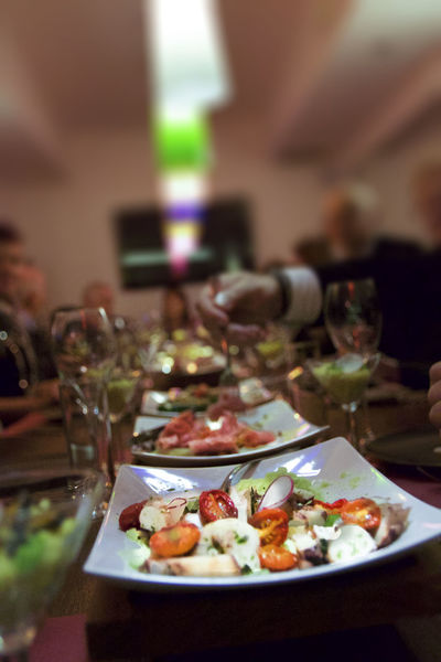 Business Dinner Focus On Foreground Food Food And Drink Freshness Glass Healthy Eating Household Equipment Incidental People Indoors  Meal Plate Ready-to-eat Restaurant Selective Focus Table