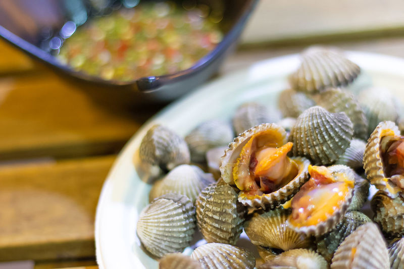 High angle view of clams in plate on table
