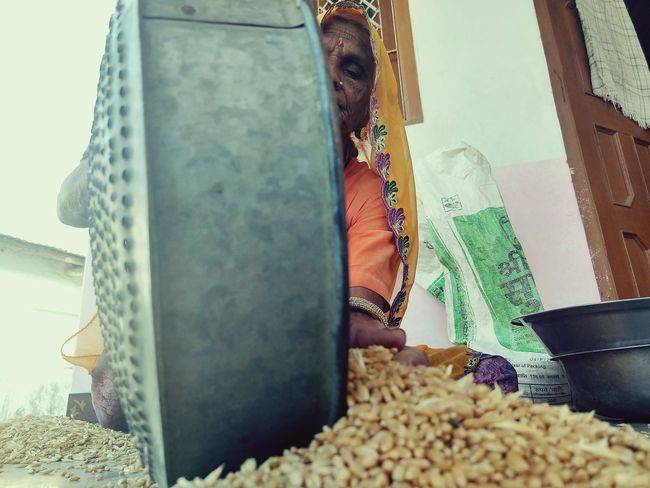 It was nice conversation with amma. There use to be Jowar (sorghum) now nowhere to find. Now people sow cash crops such as Mustered, Soyabean, Garlic and wheat. And i bought this 5 kg wheat from Govt. ration shop for ₹2 per Kg. It's good also as you don't need that much cleaning and sorting as need to do with which you get from your own farm. Rajasthan Photo India Women Development Tribal Women Tribal Livelihood Best Of EyeEm Bestoftheday Busy EyEmNewHere Rural EyeEmNewHere