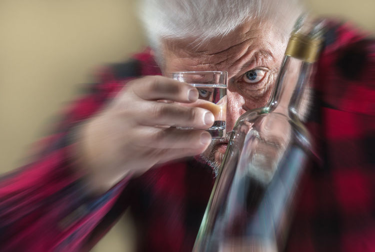 a drunk man looks at his shot glass Drinker Addicted Adult Alcohol Alcoholic  Close-up Concentration Drink Drinking Food And Drink Glass Headshot Holding Human Body Part Human Face Indoors  Looking Men One Person Portrait Problem Refreshment Selective Focus Senior Adult Vodka