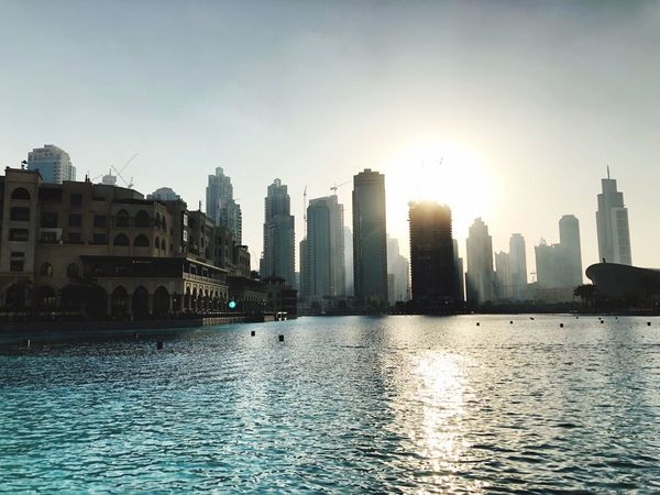 Sunset Maritime Dubai Building Exterior Architecture Skyscraper Water City Built Structure Waterfront Cityscape Sunlight Urban Skyline Outdoors Modern Travel Destinations City Life Sky Clear Sky Day No People Sea Nature