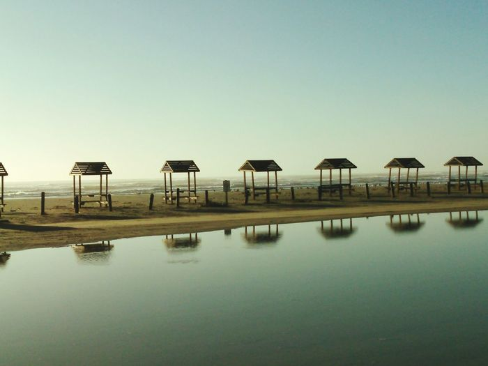 Picnic Tables on the Beach Beach Photography Water Reflections