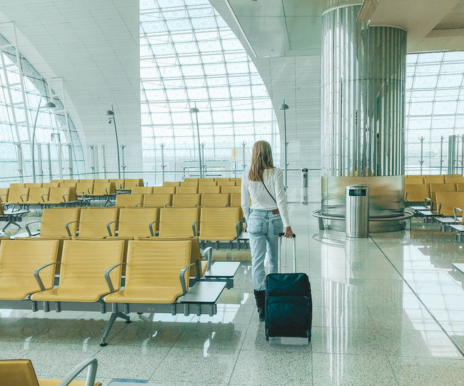 Airport Adult Women Airport At The Airport Waiting At The Airport Luggage Baggage Flying Travel Destinations Traveling Airport Terminal Transportation Passenger