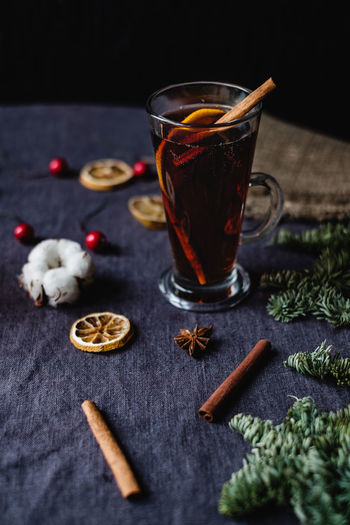 Still life shot of mulled wine Mulled Wine Food And Drink Refreshment Drink Glass Red Wine Winter Drinks Still Life Spice Drinking Glass Table Cinnamon Sticks Cinnamon Freshness Healthy Eating Hot Drink Ingredient Wellbeing Food Alcoholic Drink Beverages