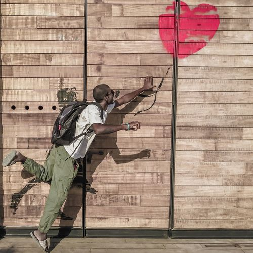 Chase it... Full Length Built Structure Day Men Adult Weapon Outdoors One Man Only Only Men One Person Architecture People City Adults Only Heart Heart Shape Heart ❤ Heartbeat Moments Hearts Love Runningheart Running Runningman Heartbroken Heartshape Be. Ready. The Street Photographer - 2018 EyeEm Awards