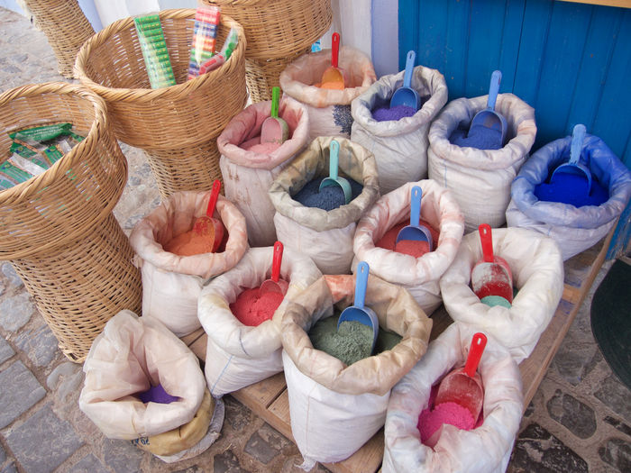 High angle view of colorful powdered paint in sack for sale