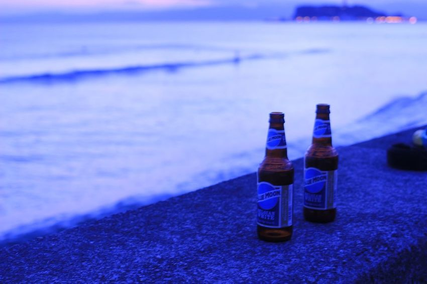 Seaside Sea And Sky Waves Beer Bottle No People Alcohol Drink Sea Blue Outdoors Day Nature Beach Sky Close-up
