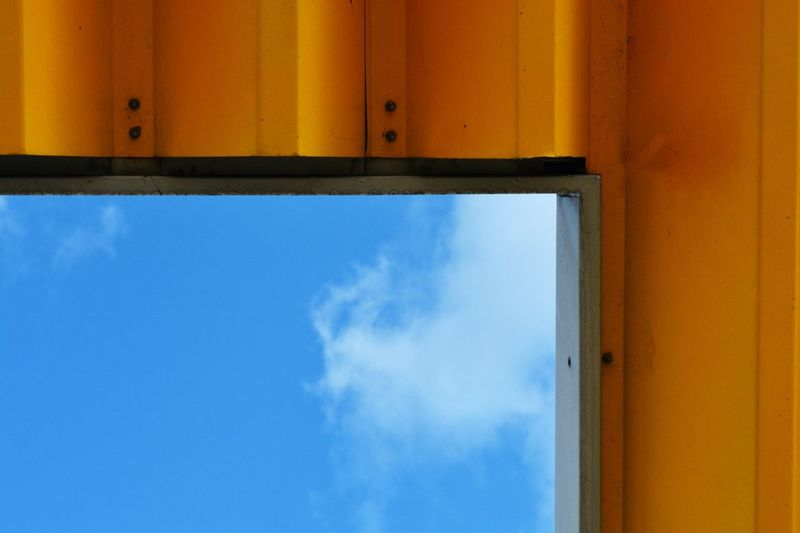 Close-up of cropped window against blue sky