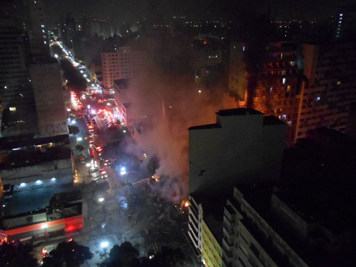 Building Collapse: Inner City Calamity in downtown São Paulo at Largo do Paissandú; 3 am May 1, 2018. The abandoned former Federal Police steel and glass skyscraper, which had been invaded by street people, imploded this early morning and the neighboring building has caught on fire as well. This photo taken between 4 am to 5 am, May 1, 2018 at Largo do Paissandú. Current Events Destruction Largo Do Paissandu May 1, 2018 New On Eyeem Night Photography Susan A. Case Sabir The Week on EyeEm Unretouched Photography About 4 Am Building Collapse Building Fire Building Implosion Burning Building Close-up Shot Controlled Chaos Dangerous Situation Downtown São Paulo High Angle View Implosion Responsiveness Smoke - Physical Structure Unexpected Event Urban Photography Urban Strife