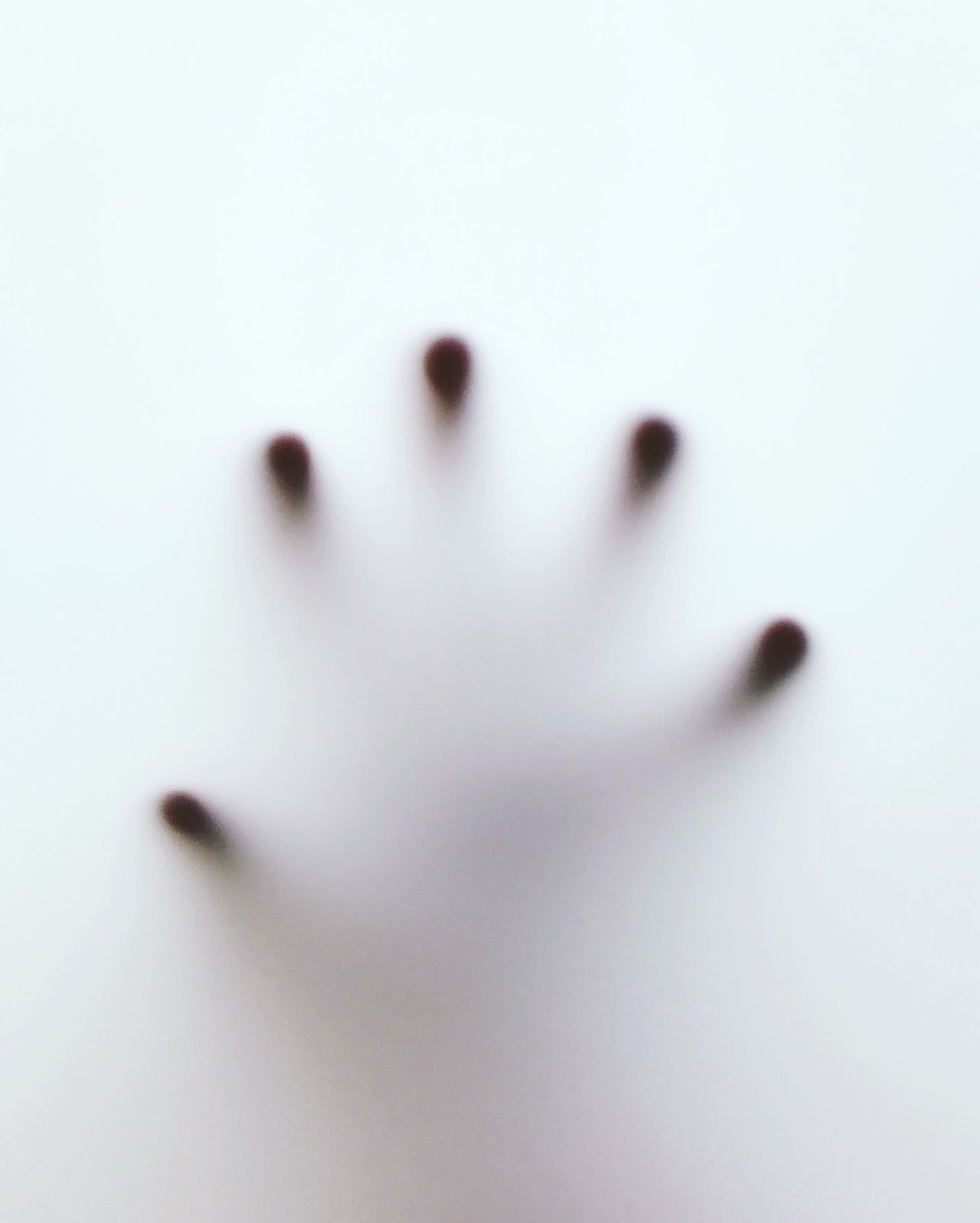 Close-up of human hand on condensed window