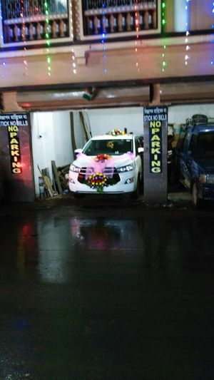 A Flower Decorated Car for Bride & Groom Reflection Car Night Illuminated Water Indoors  No People
