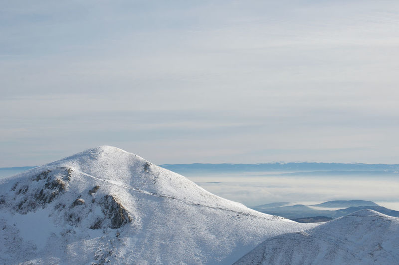Scenic view of snowcapped mont sancy mountain against sky in auvergne france
