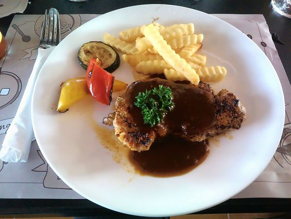 Pork steak in restaurant Pork Steak Steak Meat Dinner Food Restaurant Meal Abstract European Food Breakfast Grill Vegatables Decoration Dish Restaurants