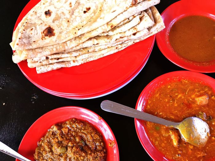 Fill your tummy with capati. Capati Savoury Pakistanifood Delicious EyeEm Selects Red Table Directly Above Close-up Food And Drink
