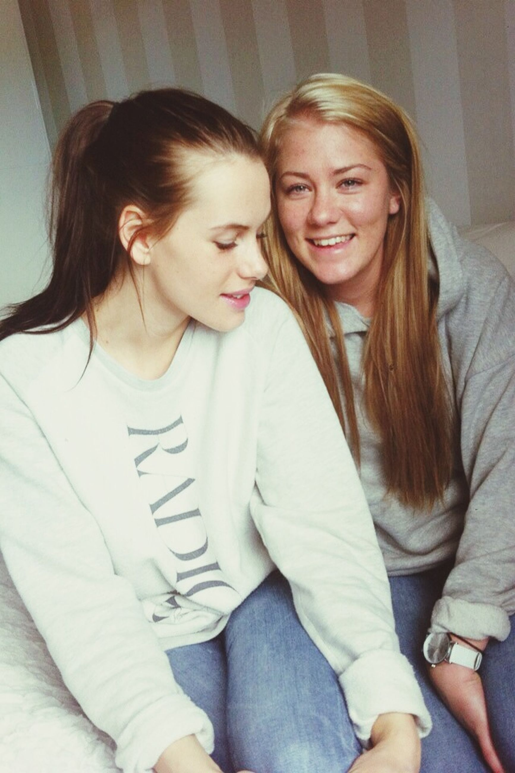 person, bonding, togetherness, lifestyles, young adult, portrait, love, smiling, casual clothing, happiness, front view, leisure activity, looking at camera, young women, indoors, three quarter length, family
