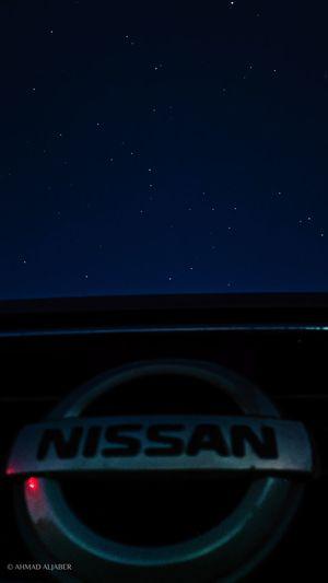 Close-up of illuminated car against sky at night