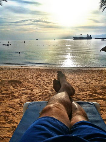 Nature Adult Horizon Over Water Only Men Barefoot Human Body Part One Person Lifestyles One Man Only Relaxation Human Foot Day Leisure Activity Outdoors Dog Sand Men Water Personal Perspective Human Leg Close-up Mammal Pets Low Section
