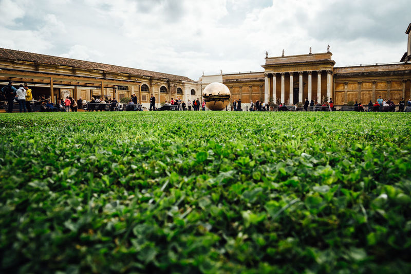 Grass Low Angle View Rome Tourist Tourist Attraction  Travel Architecture Building Exterior Built Structure Museum Outdoors Real People Sculpture Travel Destinations Vatican Museum