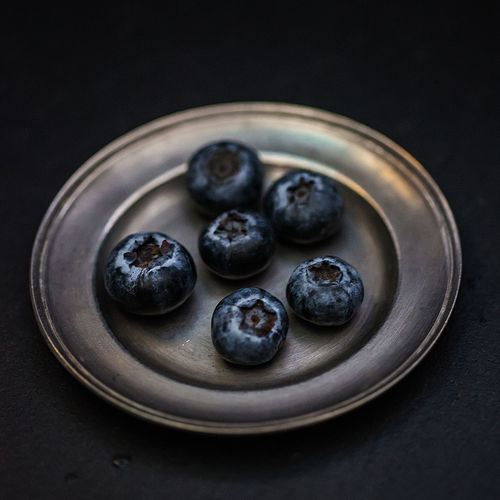 blueberry on a plate Black Background Blueberry Close-up Day Food Freshness Fruit Healthy Eating Healthy Lifestyle Indoors  No People Simplicity Slow Life Still Life Table Vegetarian Food