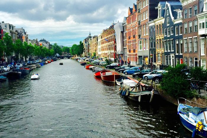 Amsterdam Colorful Buildings Boats Building Exterior Architecture Built Structure Transportation Mode Of Transportation Water City Nautical Vessel Cloud - Sky Building Nature Waterfront Canal Residential District Outdoors Incidental People Day My Best Travel Photo