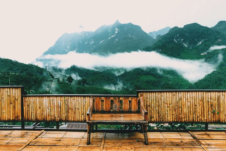 Seat... Green Color Mountain Sky Nature Seat Water Day Beauty In Nature No People Wood - Material Railing Scenics - Nature Plant Cloud - Sky Outdoors