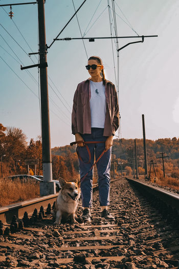 Man with dog against sky