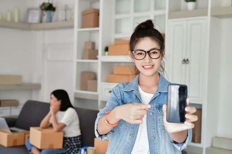 Young Adult Real People Young Women Technology Portrait Adult Front View Lifestyles Women Focus On Foreground Wireless Technology Indoors  Holding Connection Casual Clothing People Two People Communication Eyeglasses