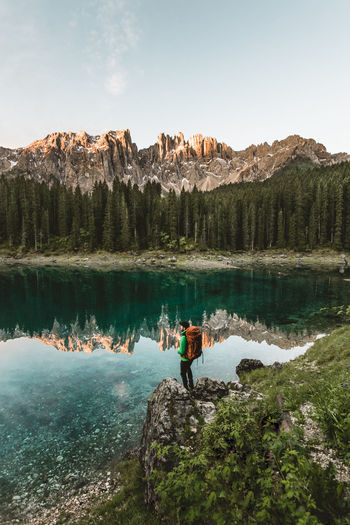 Young man standing on a rock watching the reflection of the Dolomites mountains on the water. Dolomites Hiking Travel Photography Cristal Clear Water Explorer Full Length Hike Hiker Italy Lake Leisure Activity Lonely Man Mountain Range Nature Nature_collection Non-urban Scene One Person Outdoor Photography Outdoors Reflections In The Water Rock Formation Scenics - Nature Sky Travel Destination Water EyeEmNewHere The Traveler - 2018 EyeEm Awards A New Beginning Capture Tomorrow It's About The Journey 2018 In One Photograph