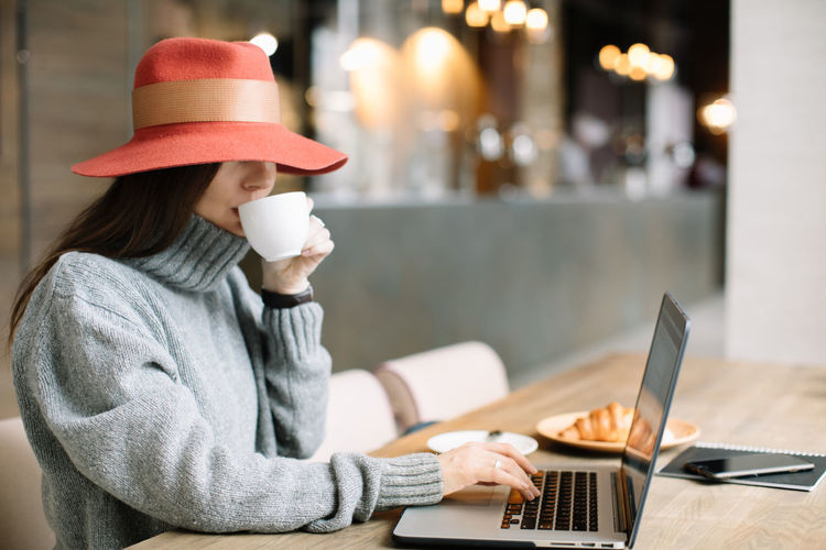 2b774a2c7674f Food And Drink Hat Red Woman Working Backgrounds Beautiful Woman Blogger  Cafe Cappuccino Coffee Break Coffee