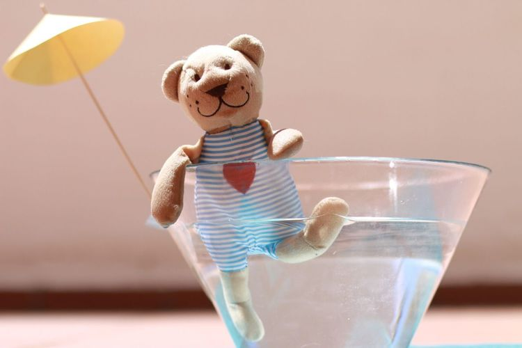 Close-up of stuffed toy in drink on table