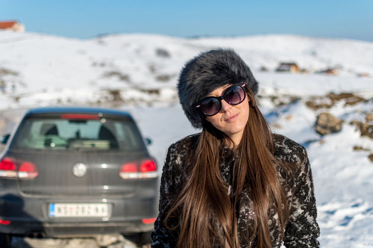 Winter Glasses Portrait Sunglasses Young Adult Clothing Fashion Cold Temperature One Person Snow Hairstyle Looking At Camera Long Hair Hair Leisure Activity Warm Clothing Front View Adult Outdoors