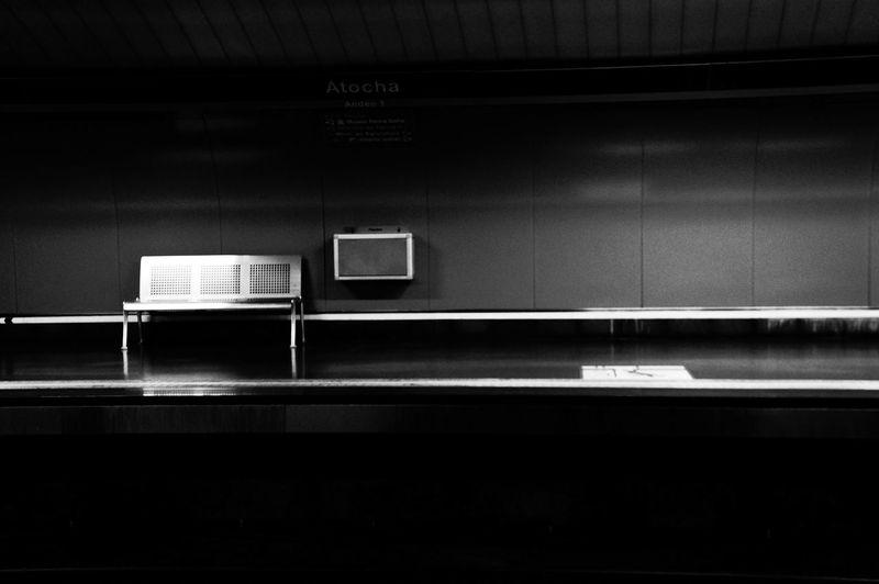 Empty metal seat on subway platform