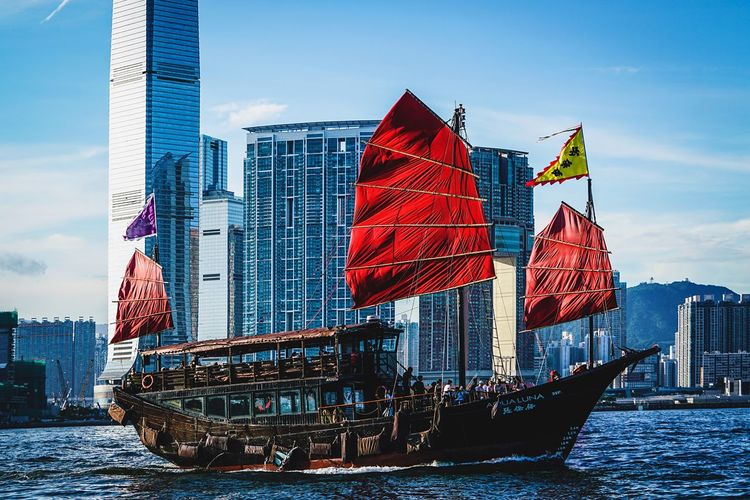Aqualuna Discoverhongkong Sky Water City Office Building Exterior Flag Architecture Building Exterior Built Structure Skyscraper Nature Tall - High Day Modern Office Waterfront Outdoors Financial District  Building No People Patriotism