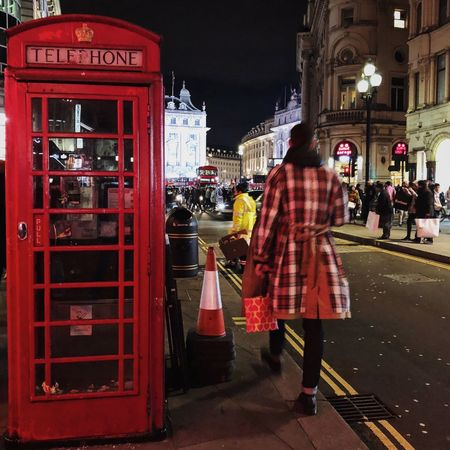 Typical London Great Britain British Telephone Box Telephone Booth Telephone Sherlock Street London Building Exterior Real People Built Structure Architecture Street Walking Night City Men Red Pay Phone First Eyeem Photo