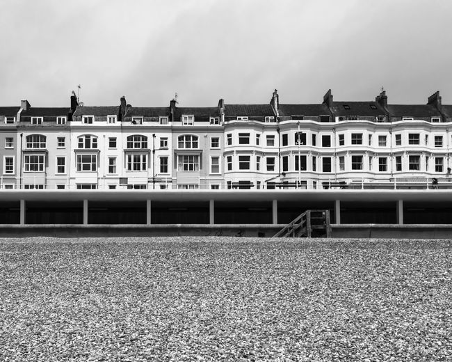 Row of houses from Hastings Beach, Hastings, United Kingdom Architecture Britain British Coastline East Hastings Houses KINGDOM Architecture Beach Building Building Exterior Coast England English House Landscape No People Outdoors Pebble Row Sea Sussex Uk United