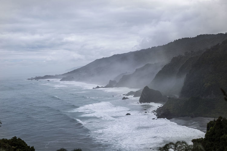 Rain and clouds at New Zealand's Westcoast. Bad Weather Cloudy Rain WestCoast Beauty In Nature Cloud - Sky Coast Day Flowing Water Mountains Nature New Zealand No People Non-urban Scene Ocean Outdoors Power In Nature Rock Scenics - Nature Sea Sky Tranquil Scene Tranquility Water Waves