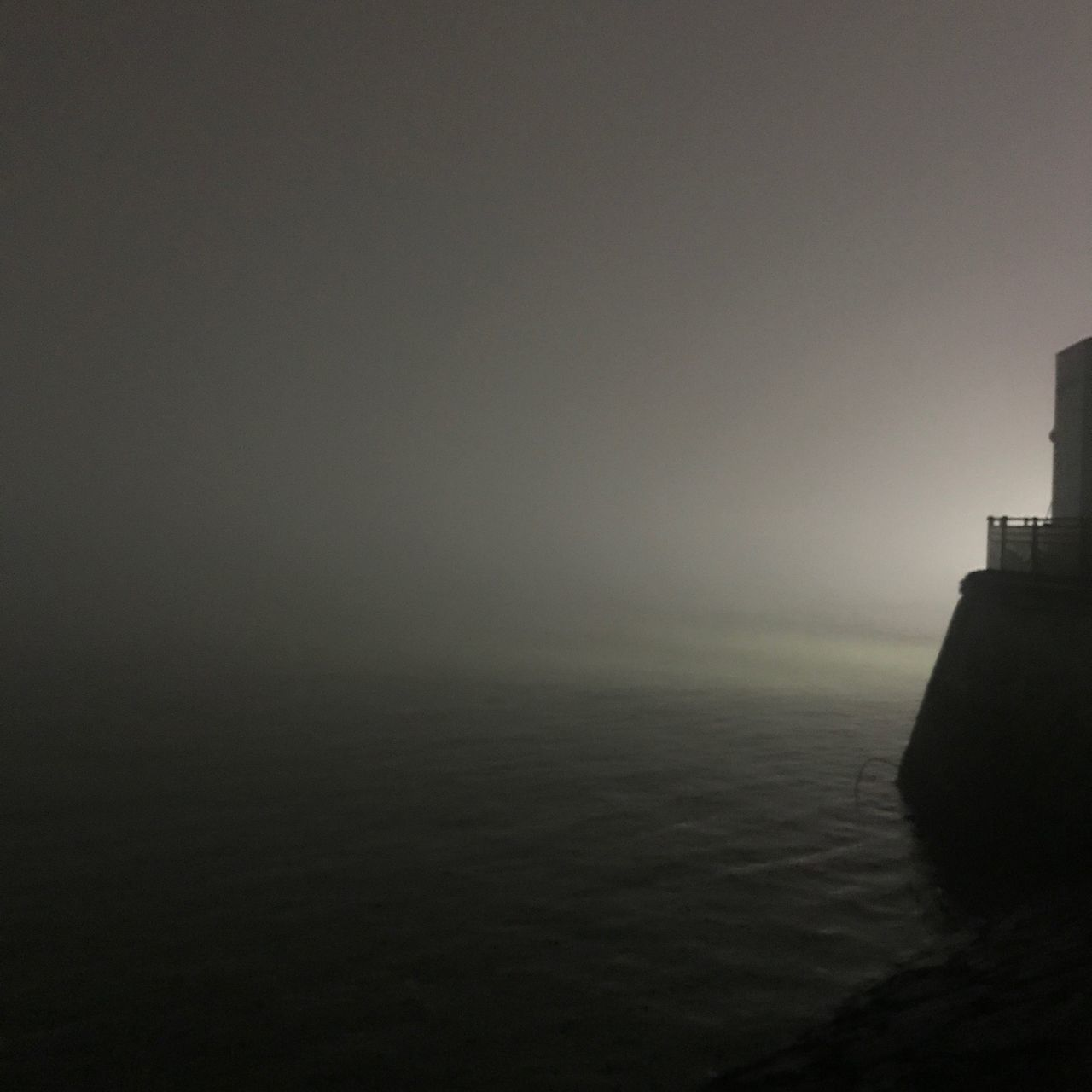 copy space, sky, fog, sea, building exterior, built structure, water, no people, architecture, tower, nature, beauty in nature, scenics - nature, tranquility, outdoors, tranquil scene, silhouette, guidance, lighthouse