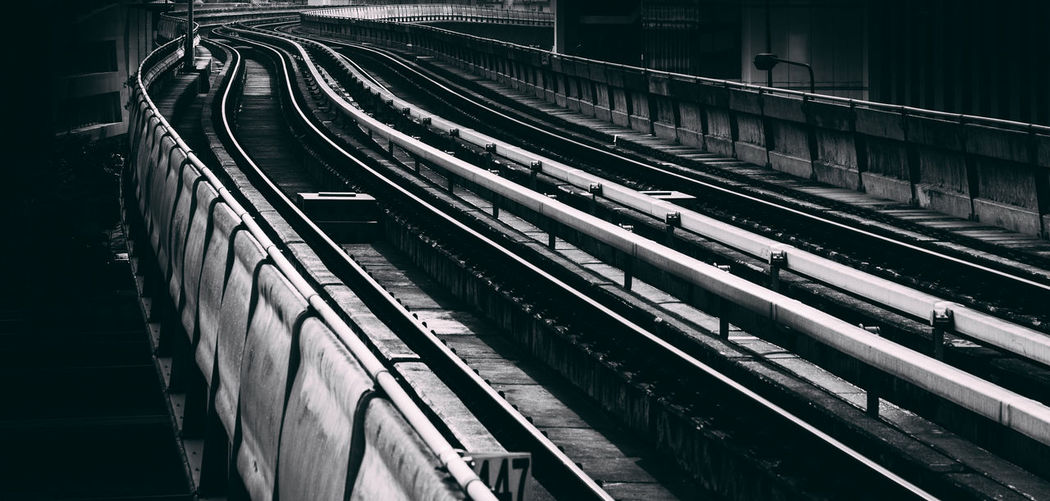 Curve Dark Station Black And White Day Electricity  No People Outdoors Public Transportation Rail Transportation Railroad Track Railway Technology Track Train Train - Vehicle Transportation Way