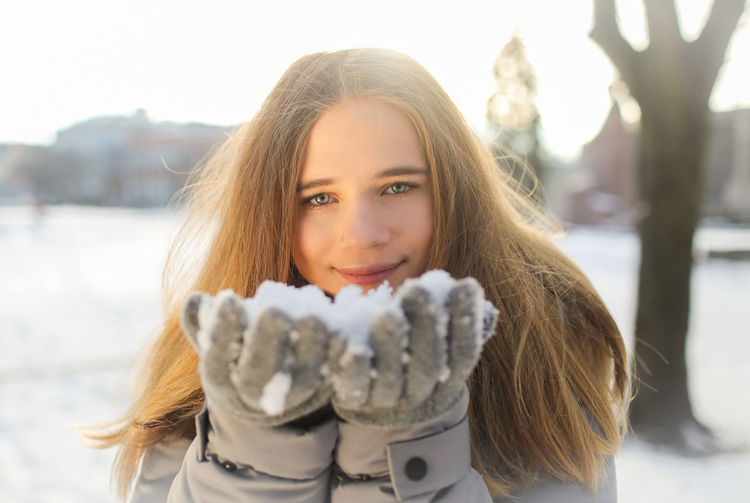 Portrait Looking At Camera Smiling Long Hair Happiness Winter Outdoors Warm Clothing