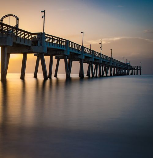 Ocean Sunrise Reflection EyeEm Selects Water Built Structure Architecture Sky Bridge Connection Bridge - Man Made Structure Sunset Pier Sea Nature Waterfront Tranquility Scenics - Nature Tranquil Scene Outdoors Beauty In Nature