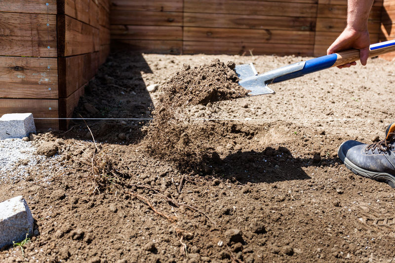 Construction Construction Site DIY Do It Yourself Earth Home Improvement Working Building Building Site Construction Site Construction Work Dig Digging Dirt Garden Ground Landscaping Outdoors Project Real People Shovel Shoveling Soil Spade Work Tool