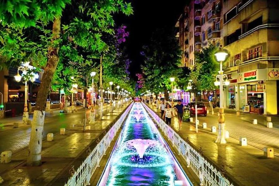 Kanalboyu, Malatya, TurkeyBuilding Exterior Architecture Built Structure City Tree Night Water Canal Multi Colored Outdoors Waterfront Diminishing Perspective City Life Colorful Springtime No People