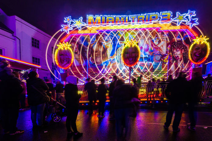 Light trails from 'Miamitrip 3' at Banbury's Michaelmas fair. Fairground Attraction Funfair Michaelmas Fair Amusement Park Amusement Park Ride Banbury Carousel Crowd Enjoyment Excitement Fair Fairground Fairground Ride Illuminated Large Group Of People Light Trace Light Trail Long Exposure Miamitrip 3 Multi Colored Neon Night People Real People Sillouette