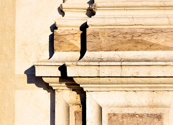 Detail of old marble column at sunset