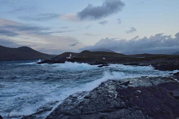 The rough sea and rugged landscape around Valentia lighthouse, Ireland. Valentia Island Ireland Landscape Water Sea Mountain Cold Temperature Sunset Beach Wave Rocky Coastline Rugged Rock Formation Geology Natural Arch Physical Geography